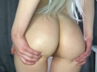 Blonde spanks herself on her wet ass after sex