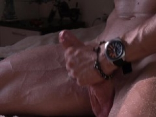 Muscular blondy guy jerk his cock and cum right on a bed
