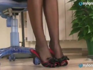 Redhead secretaries feet shoeplay in stockings and pantyhose