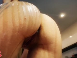 Girl with oily ass squirts close up from her toys